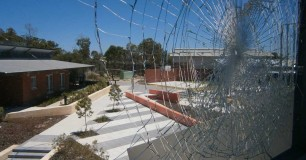 Image of a smashed window out of Yeeda unit during the Banksia Hill Riot in January 2013