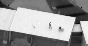 Image of detainees on roof during Banksia Hill riot in Jan 2013