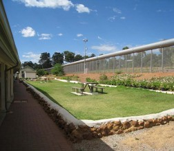 Image of a picnic table inside the perimetre fence at Wooroloo Prison Farm