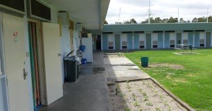Photo of prison cell doors and grassed yard area