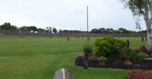 Photo of prisoners on a green grassed oval