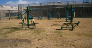 Outside gym with isometric exercise equipment for all prisoners to use