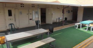 Iamage of the female prisoners yard at Broome Regional Prison with seating and tables