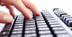 Photo of hands on a keyboard