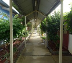 Covered walkway behind unit 1 at Bandyup Women's Prison