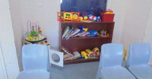 Image of toys and chairs in the children's play area at the visits centre