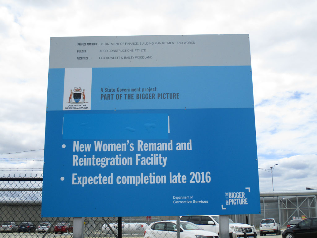 "Image of a sign about the ""New Women's Remand and Reintegration Facility"" outside Melaleuca"